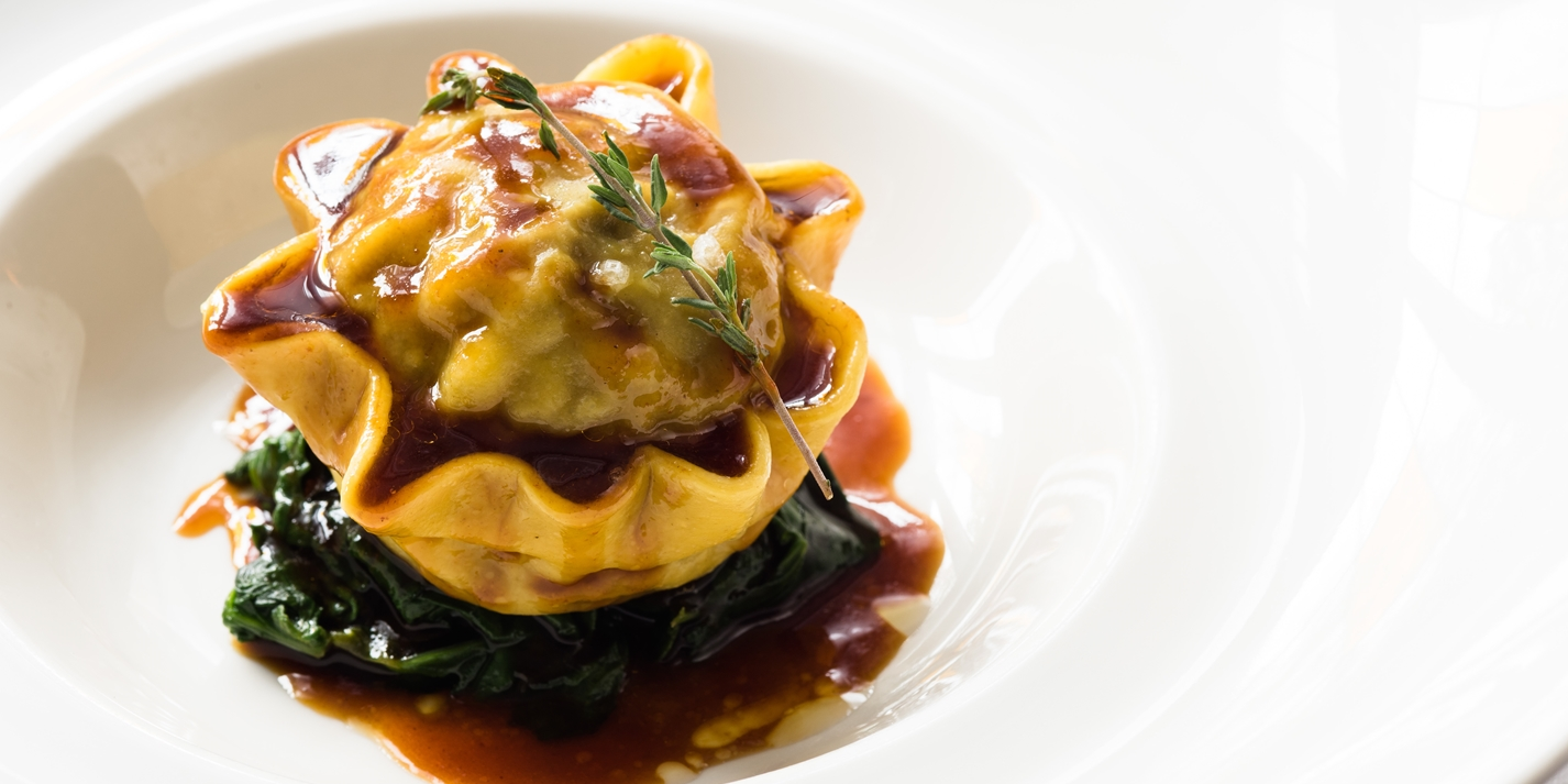 Braised Oxtail Raviolo with Celeriac, Sautéed Spinach and Oxtail Jus